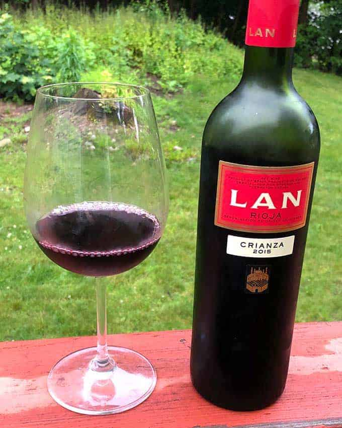 bottle of LAN Crianza Rioja with a glass next to the bottle.