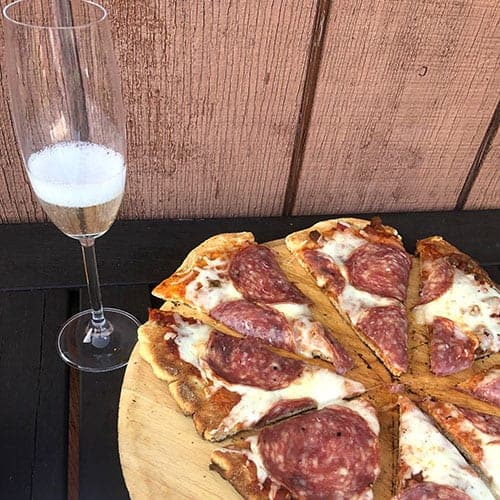Prosecco Superiore paired with salame pizza.