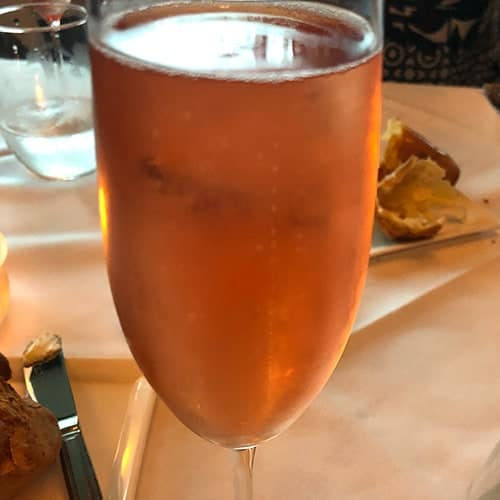 glass of sparkling rosé wine