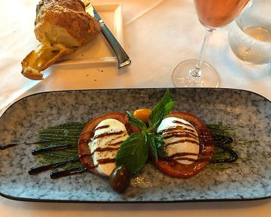 presentation of Caprese salad at Strega Prime restaurant