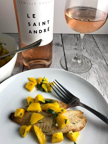 tilapia with mango salsa served with rosé wine.