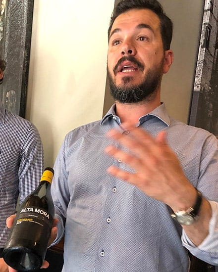 presenting an Etna Bianco wine.