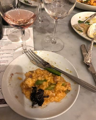 Lobster risotto paired with a rosé wine.