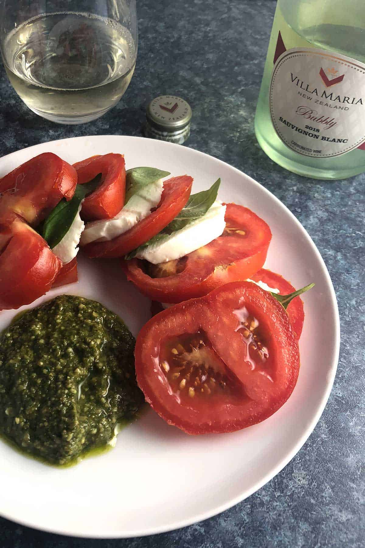 tomato caprese salad paired with a Sauvignon Blanc.