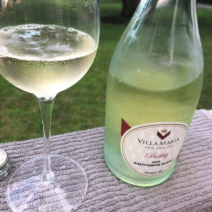 glass of Villa Maria Sauvignon Blanc with the bottle next to it.