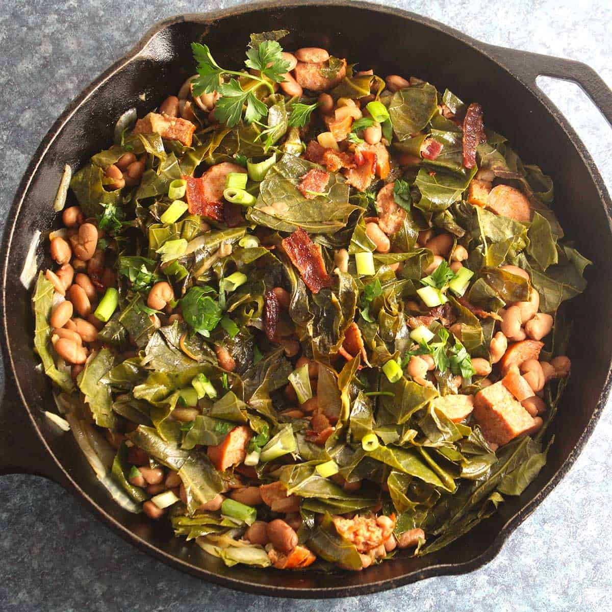 Brazilian beans and greens in a skillet.