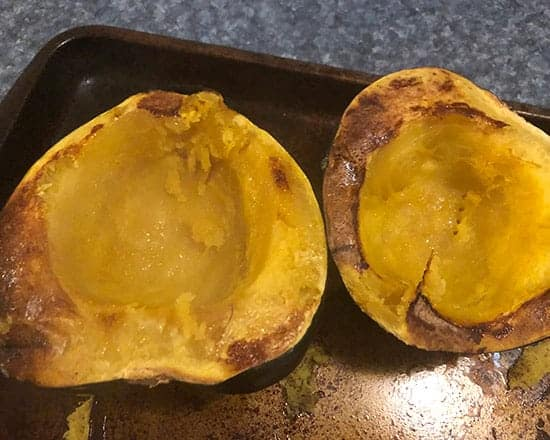 roasted acorn squash on a baking tray