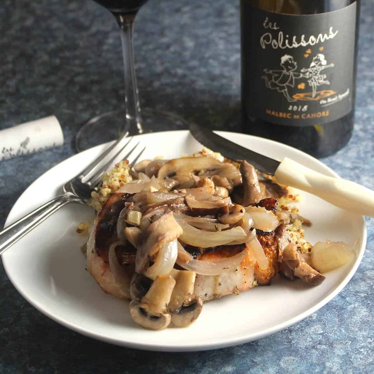 pork chops with mushroom sauce and a red wine