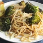broccoli pasta with sautéed garlic on a plate.