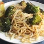 broccoli pasta with sautéed garlic on a plate.