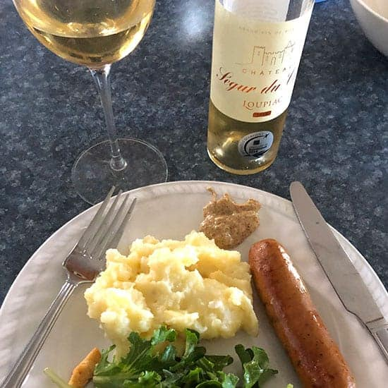 Sweet Bordeaux wine with sausage and mashed potatoes.