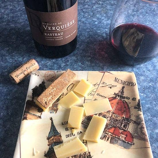 bottle of Rasteua red wine paired with Gruyere cheese.