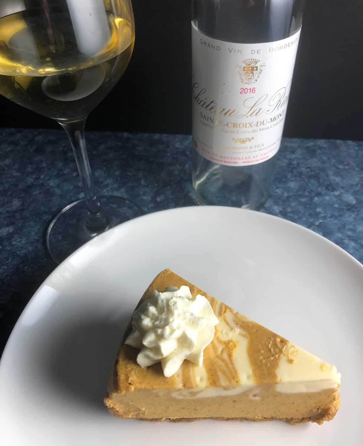 slice of pumpkin cheesecake served with a Sweet Bordeaux.