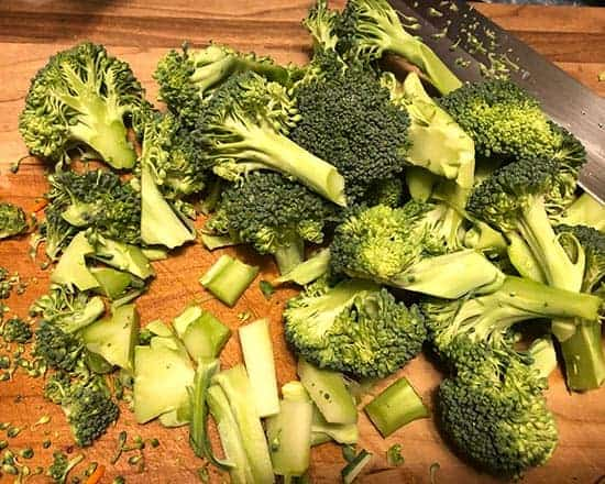 chopping broccoli on cutting board