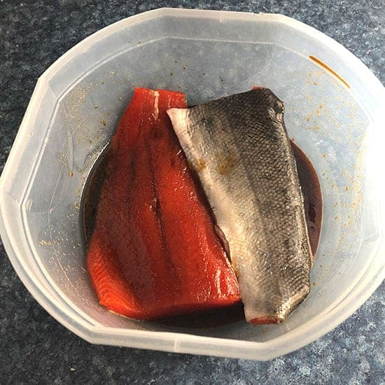 marinating salmon in a bowl