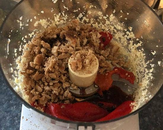 making Muhammara in a food processor.