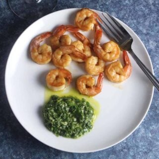 shrimp plated with cilantro dipping sauce