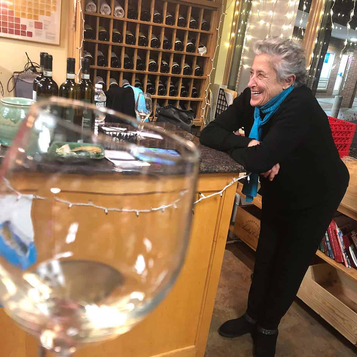 Italian winemaker visiting local wine shop