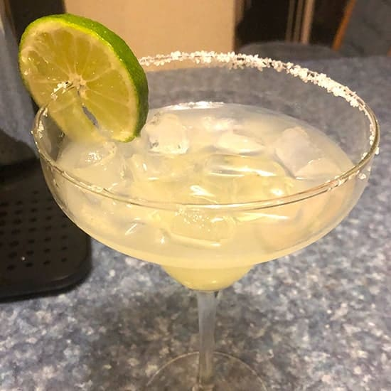 margarita in glass with salt and lime on rim