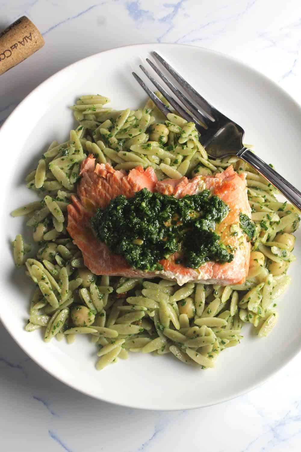 salmon plated with pesto and orzo