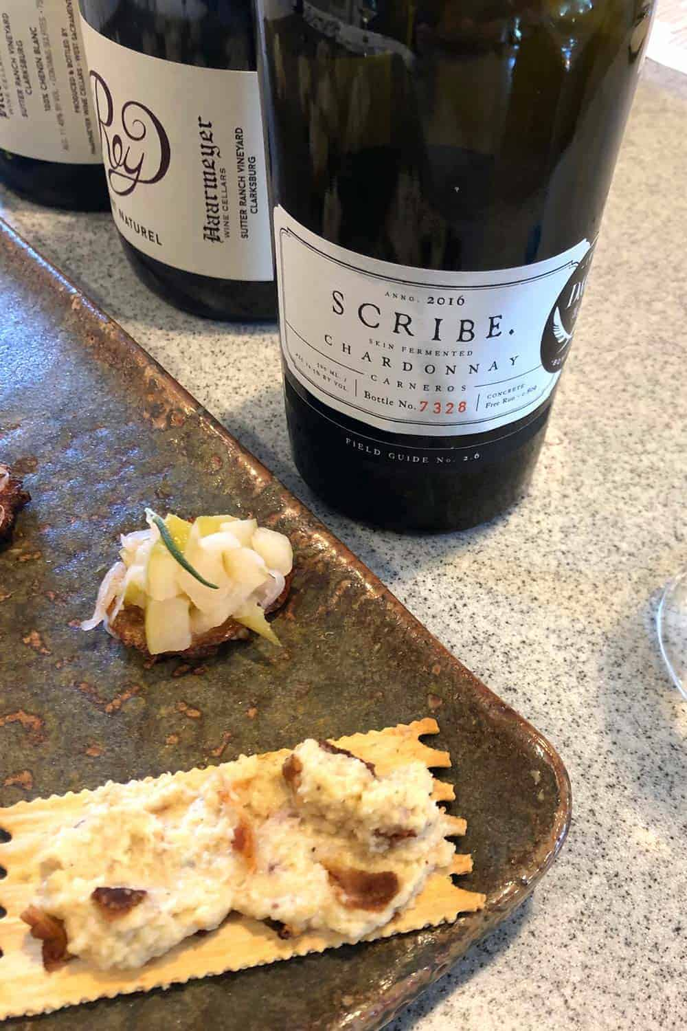 bottle of Scribe wine with appetizers