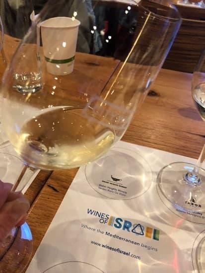 sampling a Yarden Blanc de Blanc sparkling wine.