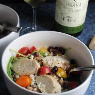 bowl of Mediterranean Chicken Salad with white wine.