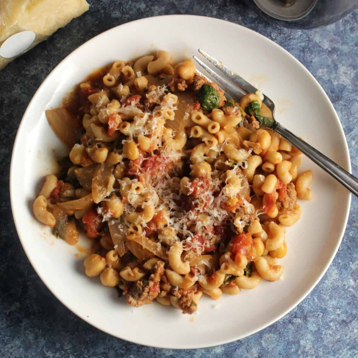 pasta sauce with ground beef and chickpeas on a plate.