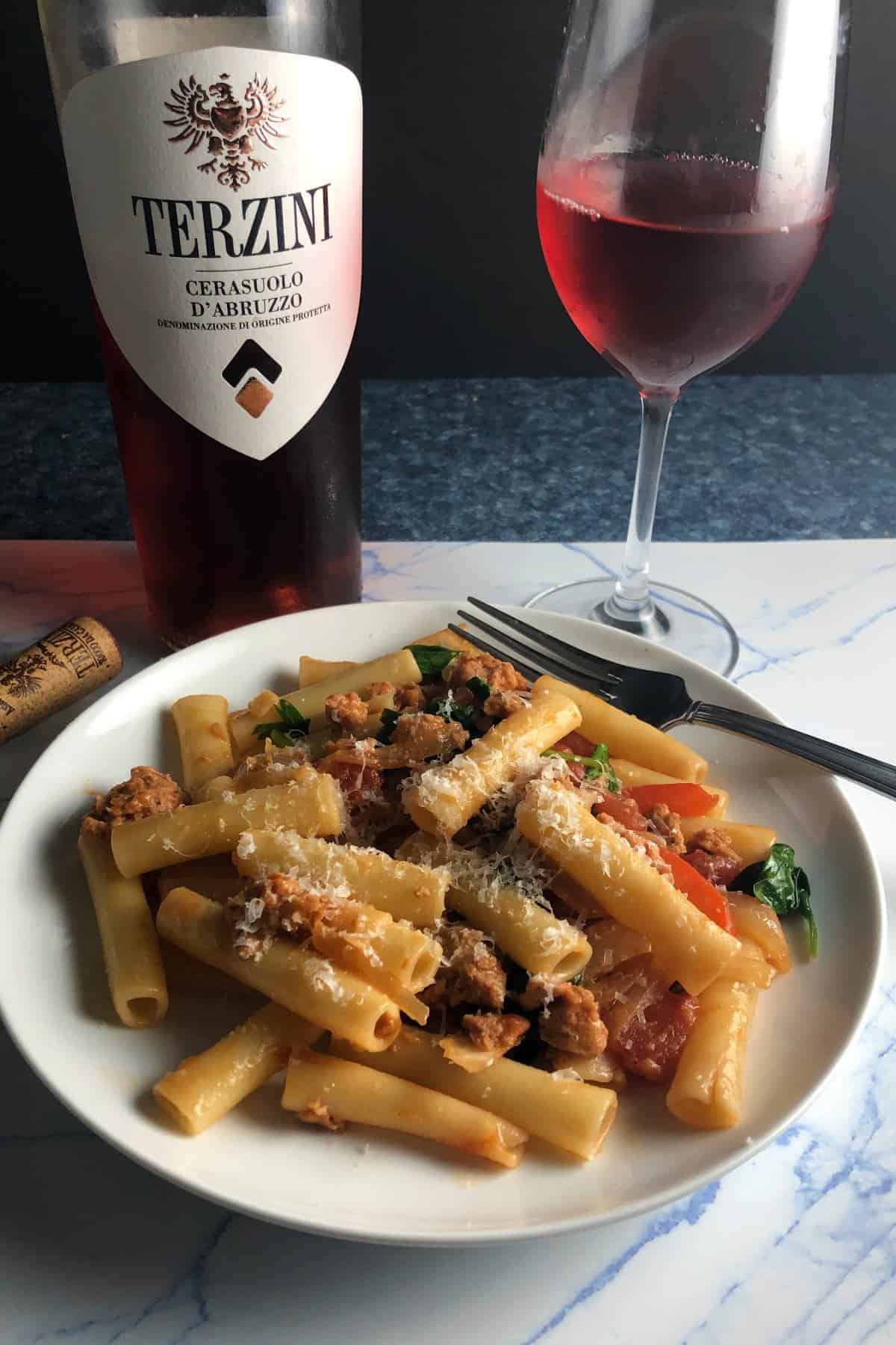 vegetarian sausage pasta paired with a rosé.