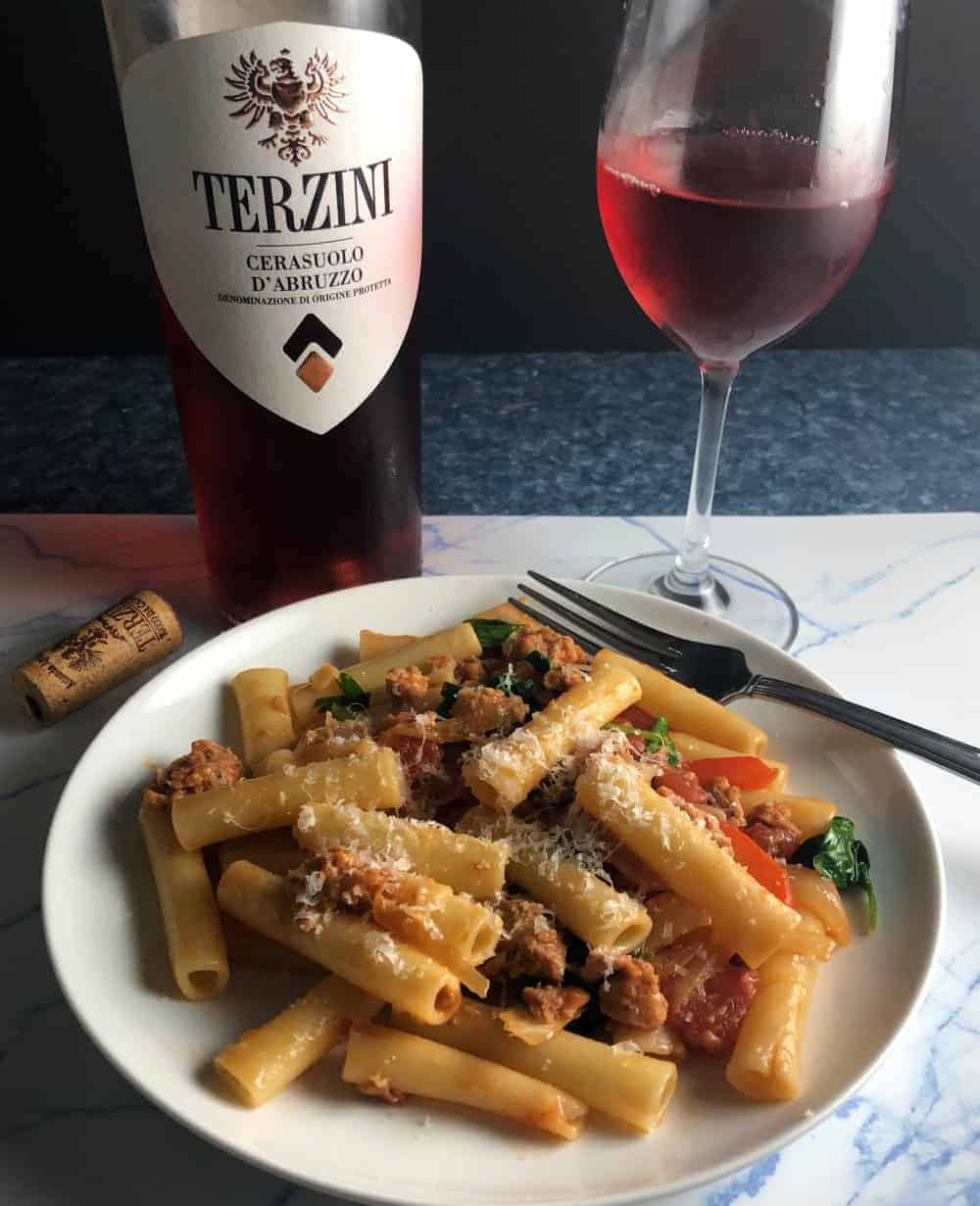 pasta dish served with a rosé wine.