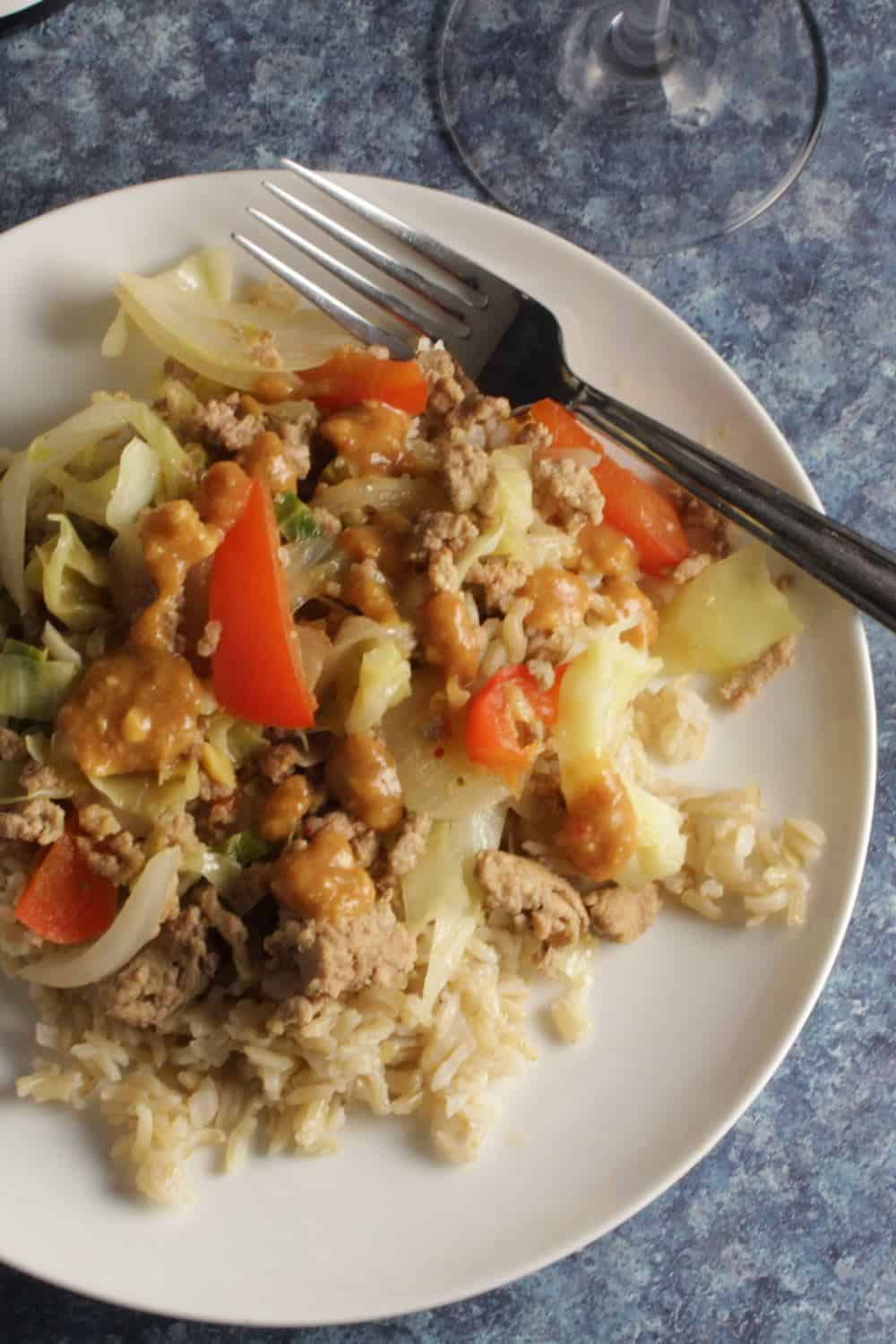 white plate with a healthy ground turkey stir-fry.