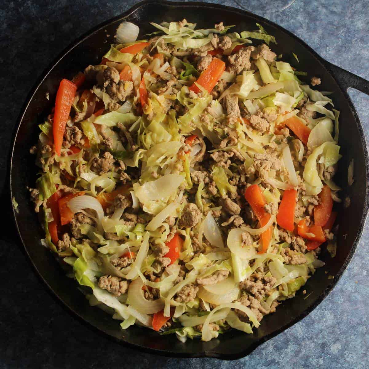 turkey and cabbage stir-fry in a skillet.