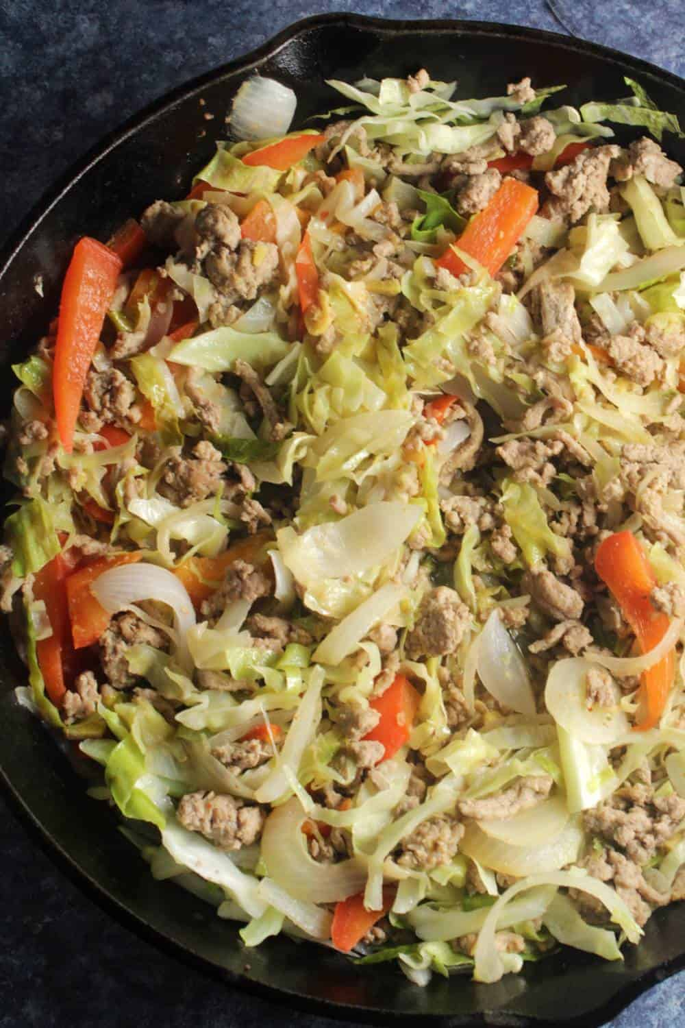 skillet with cabbage cooked with ground turkey