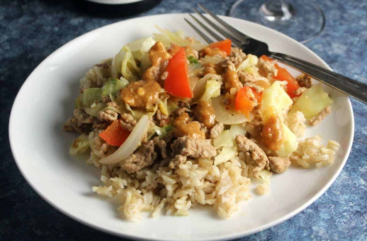 turkey and cabbage stir-fry on a white plate.