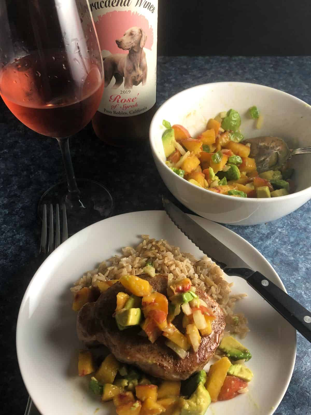 pork chops paired with peach salsa paired with a rosé wine.