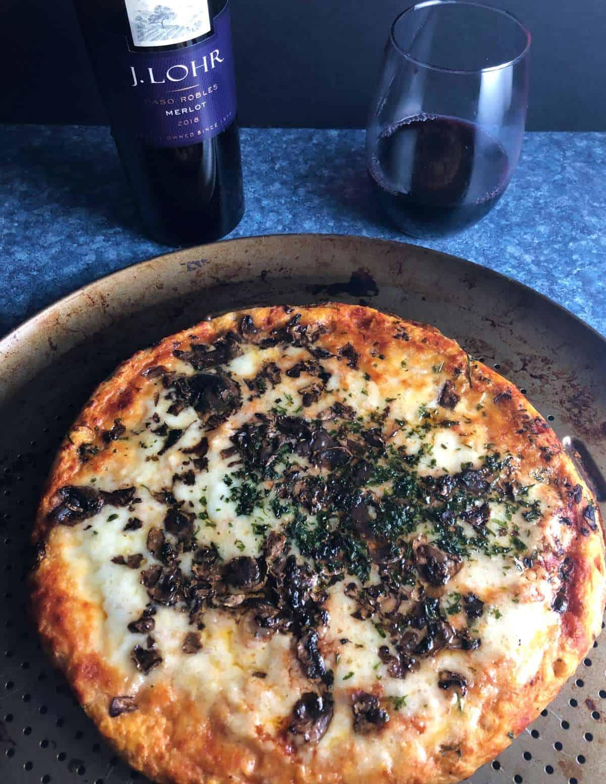 mushroom pizza served with Merlot.