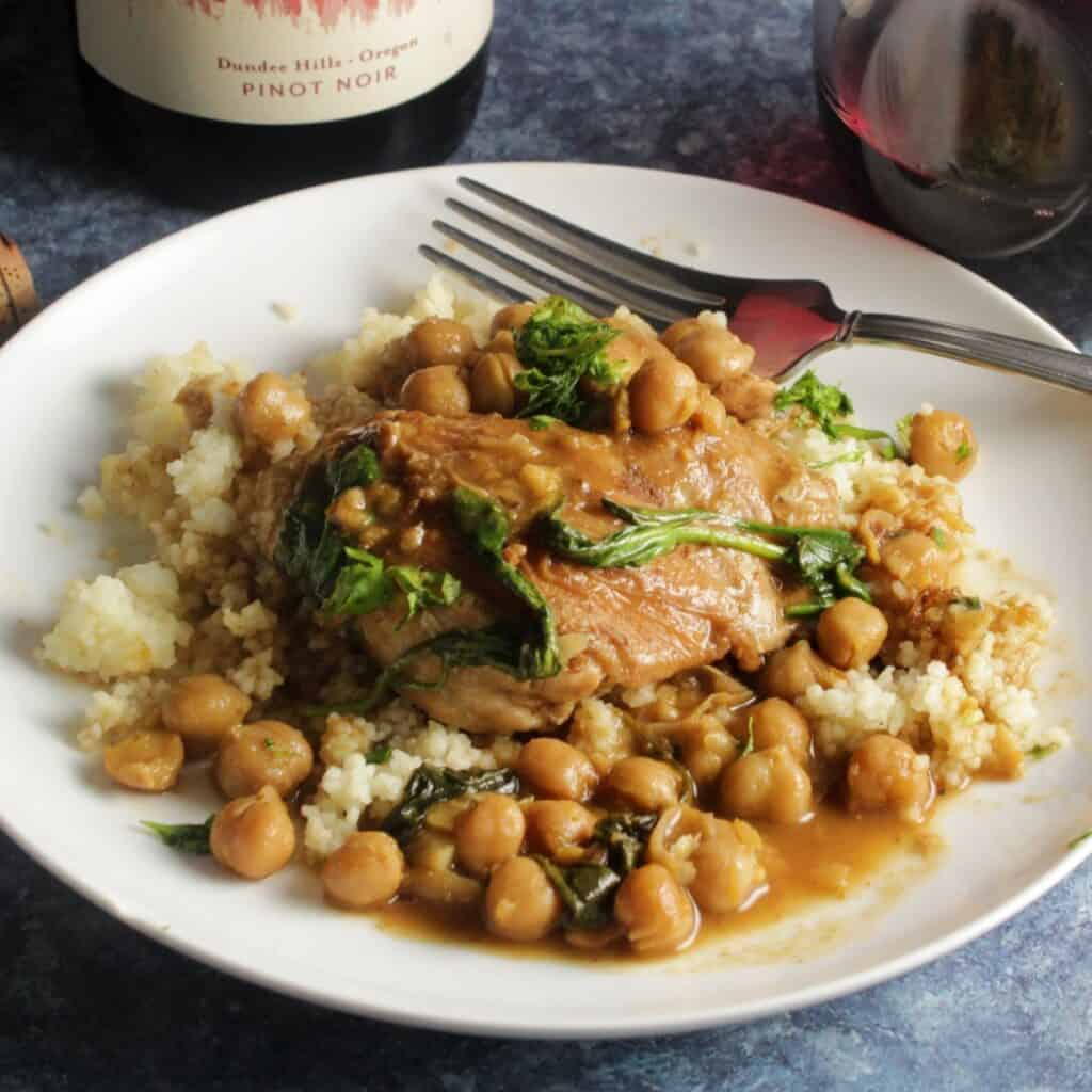 braised Moroccan chicken thighs served over couscous with chickpeas.