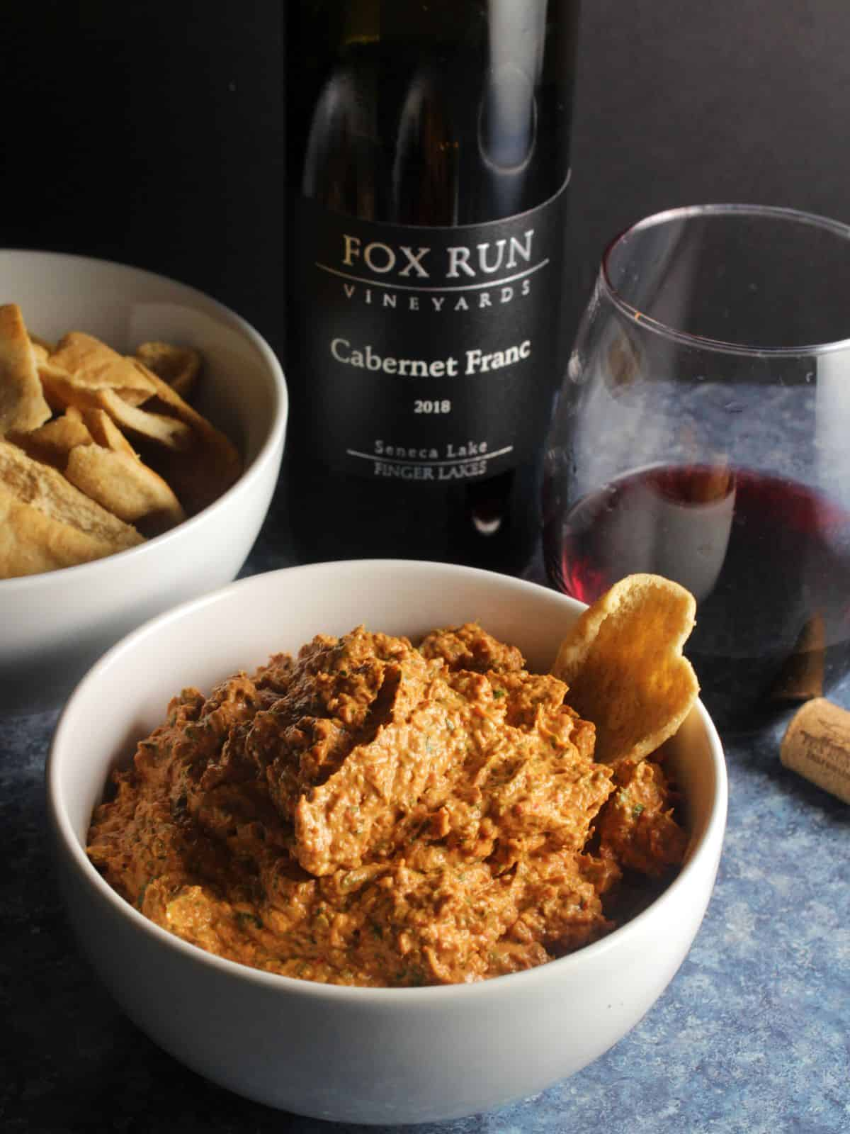 roasted red pepper dip served with red wine and pita chips.