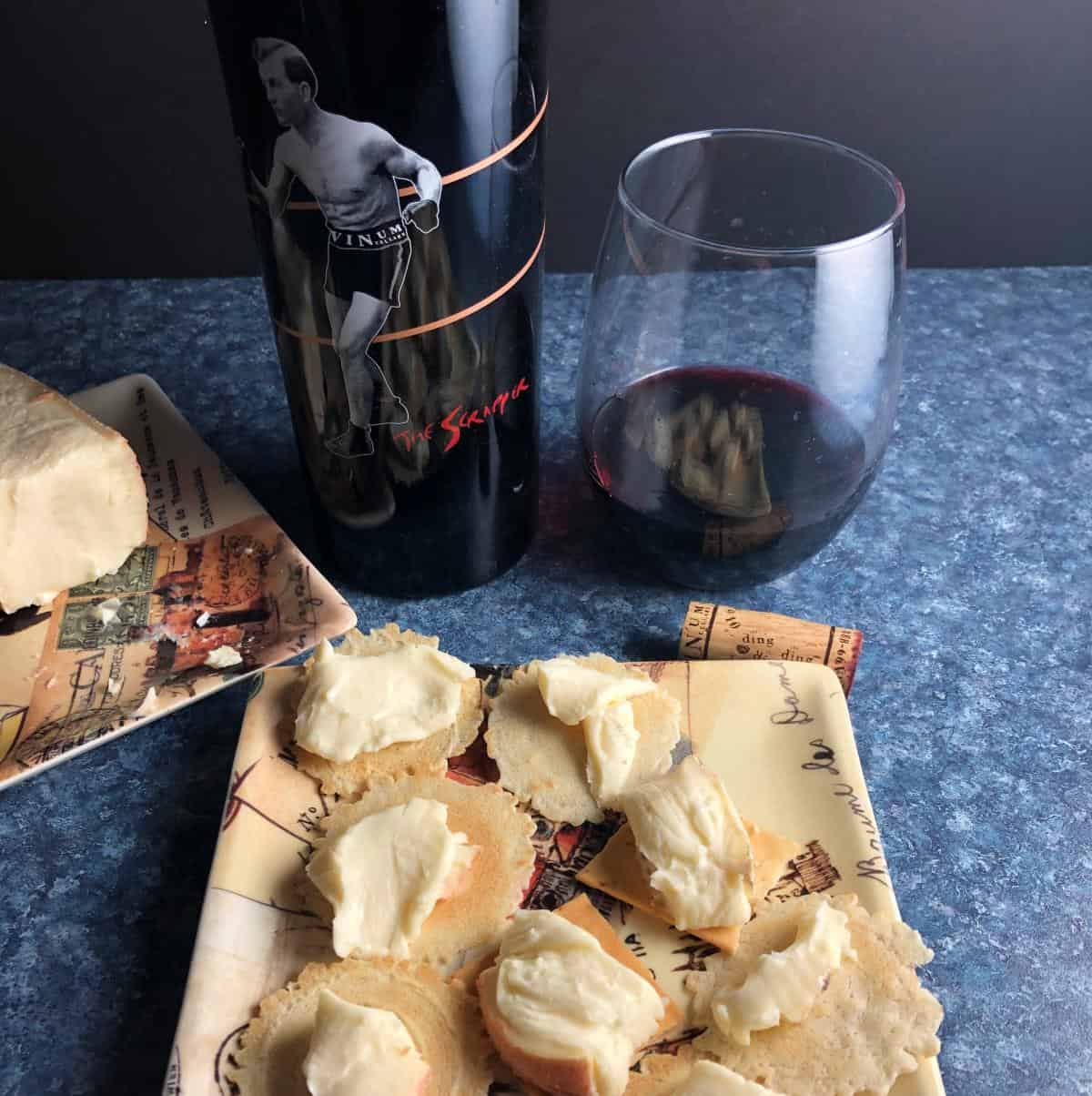 The Scrapper Cabernet Franc paired with taleggio cheese served on crackers.