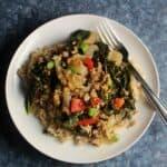 ground pork stir fry served over rice on a white plate.