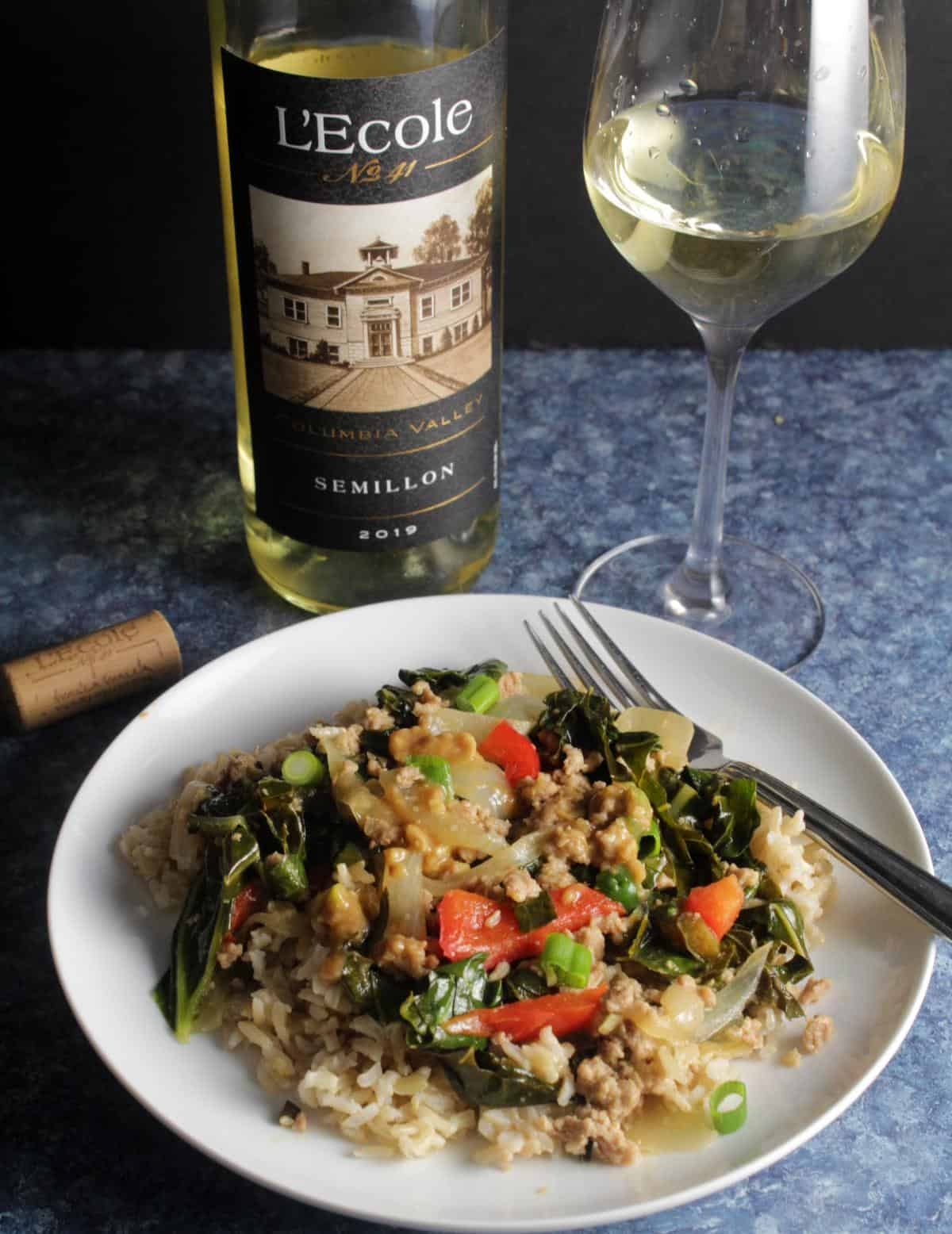 ground pork stir fry with collard greens, served over rice. Columbia Valley Semillon wine in the background.