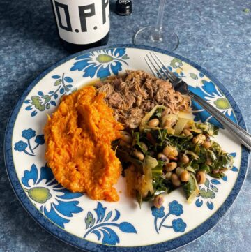 Black-eyed peas with collard greens, pulled pork and sweet potatoes, with OPP red wine.
