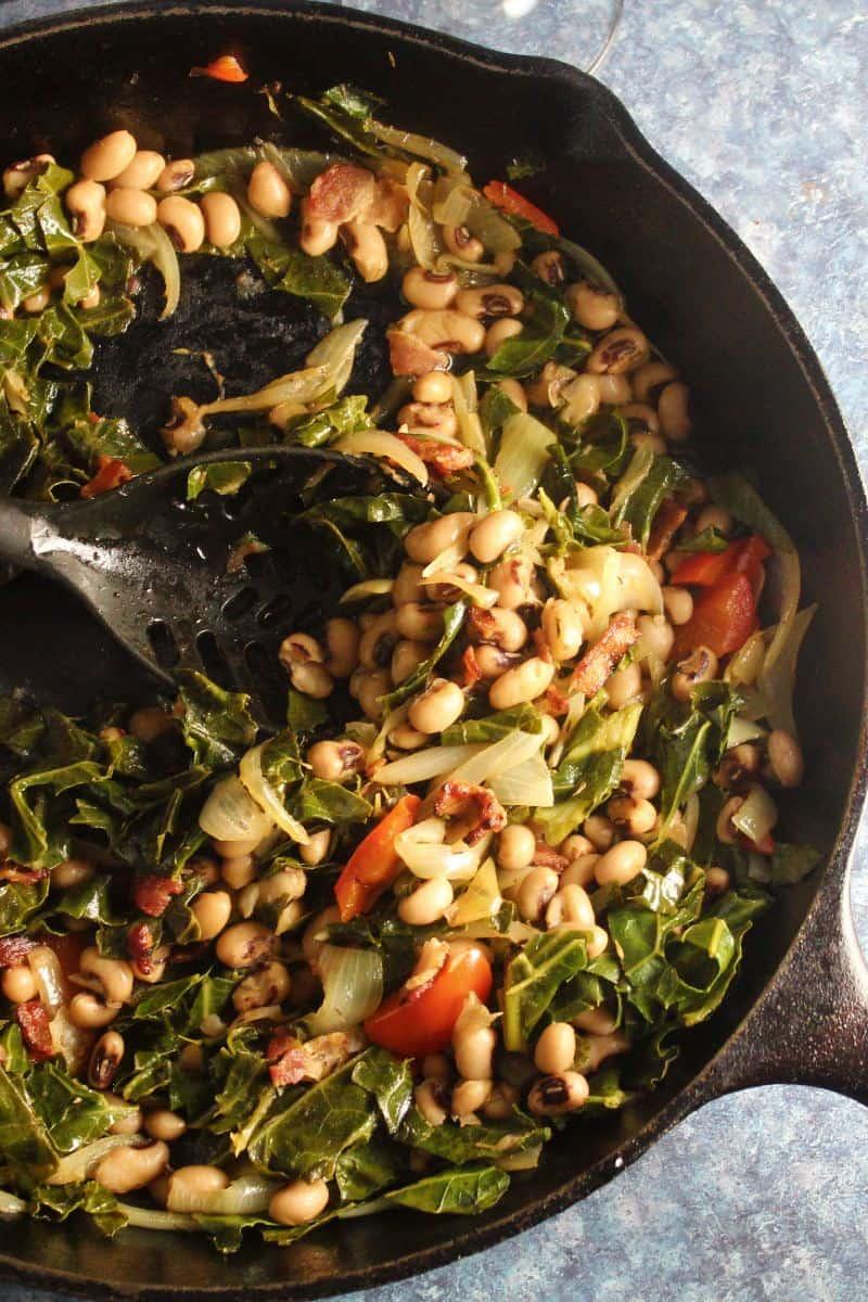 black-eyed peas and collard greens in a black skillet.