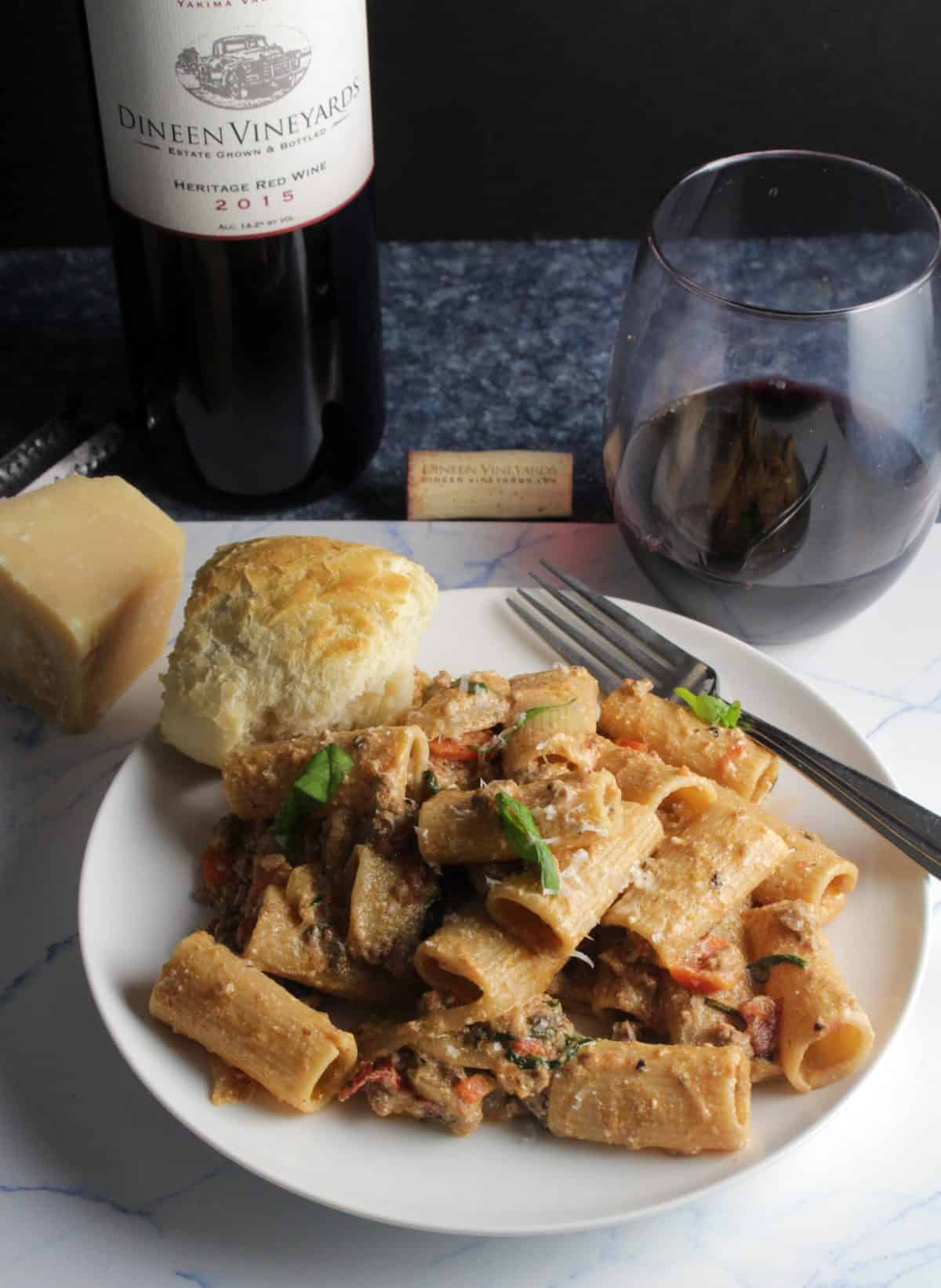 pasta on a white plate with Dineen Vineyards red wine.