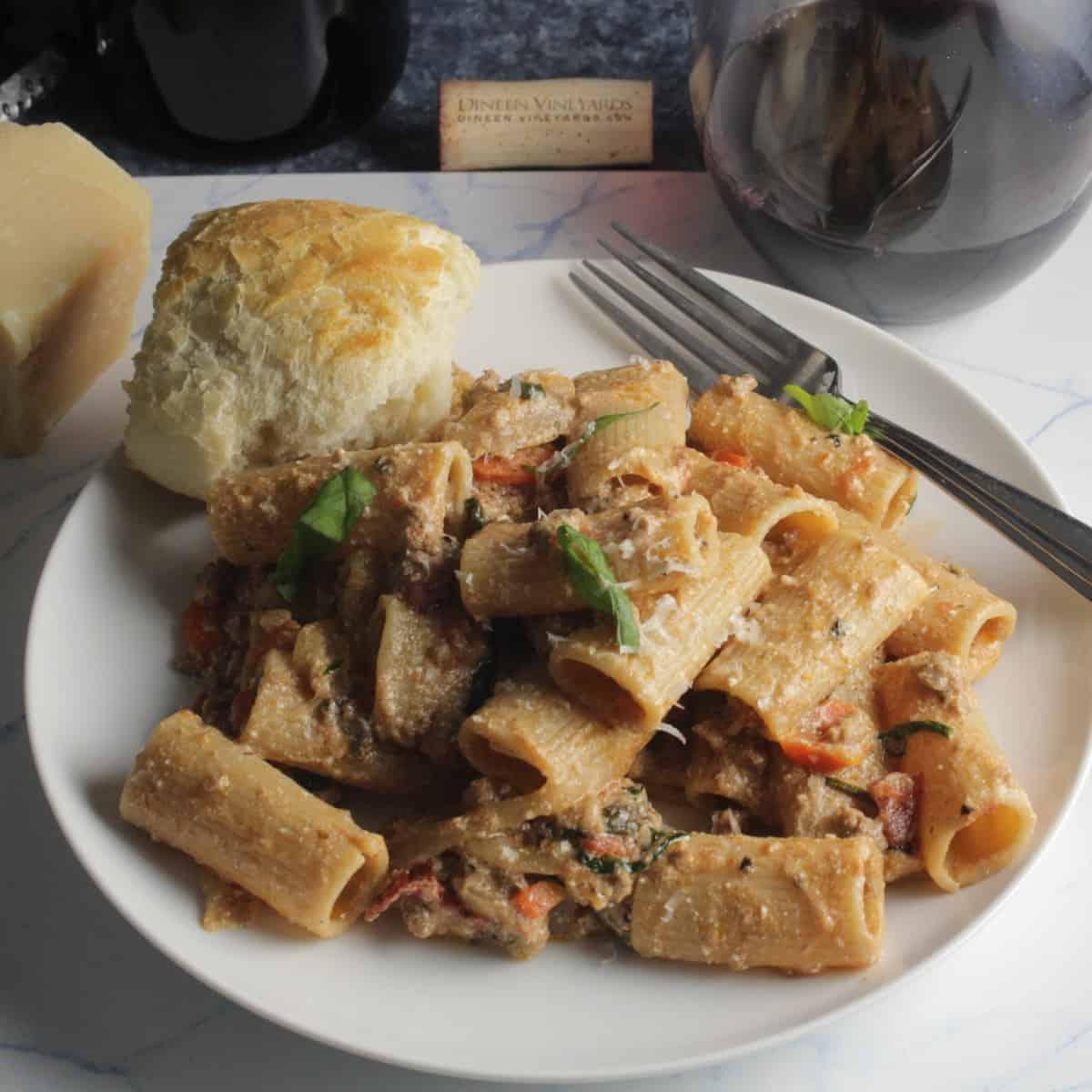plate of ground lamb ragu rigatoni.