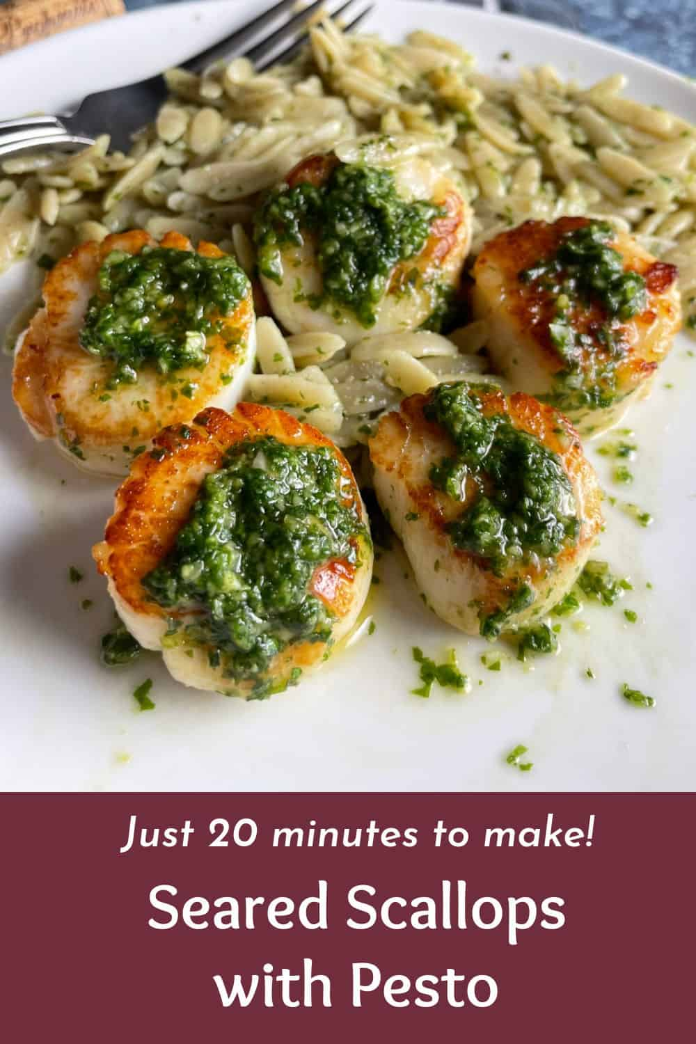 Scallops served with pesto and a side of orzo pasta. With text description underneath photo.