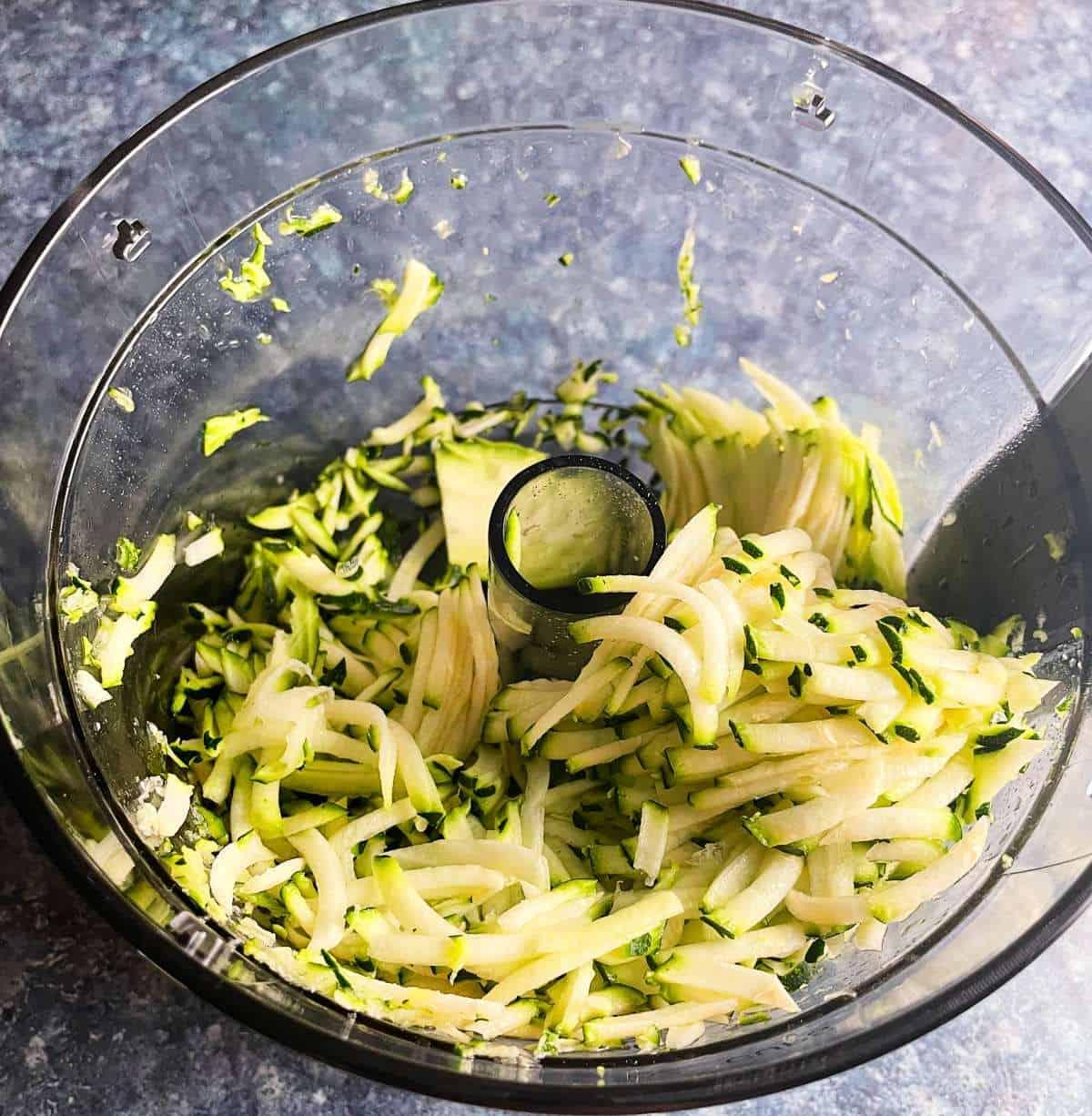 shredded zucchini in a food processor.