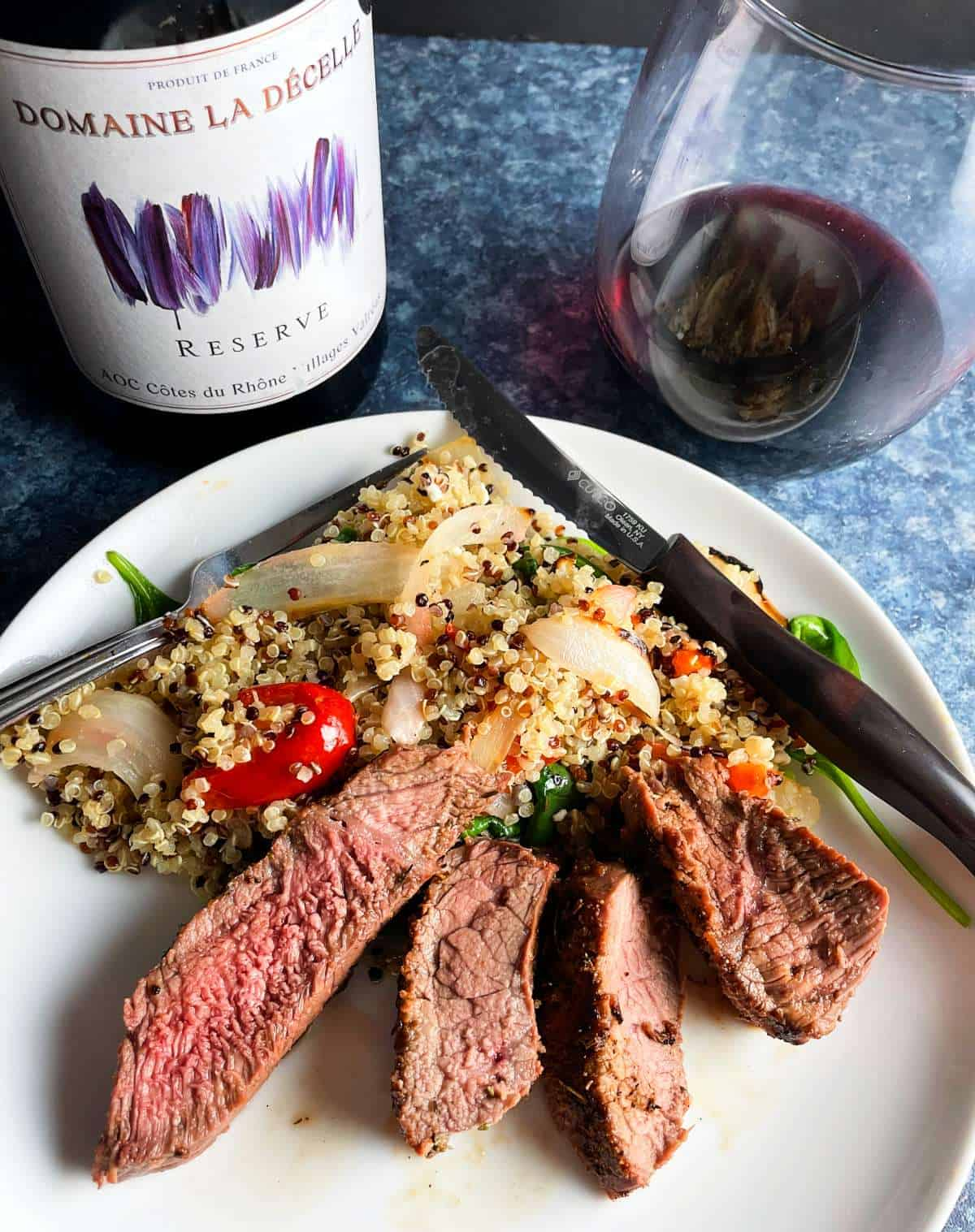 slices of sirloin steak served with quinoa and a Cotes du Rhone red wine.